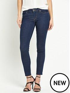 levis-711-frayed-hem-skinny-jeans