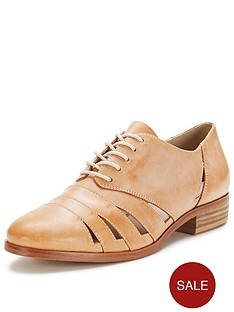 clarks-hotel-image-cut-out-light-tan-brogues