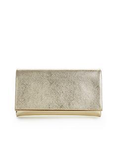 metal-bar-detail-metallic-clutch-bag