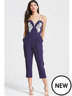 girls-on-film-girls-on-film-navy-plunge-neck-jumpsuit-with-lace-motif