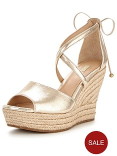 ugg-reagan-cross-front-metallic-wedge
