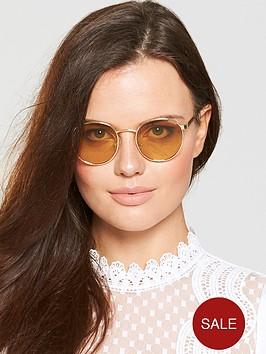 polaroid-round-lens-sunglasses-orange