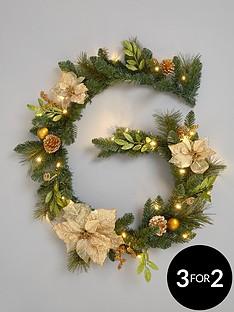 pre-lit-poinsettanbspchristmas-garland-gold