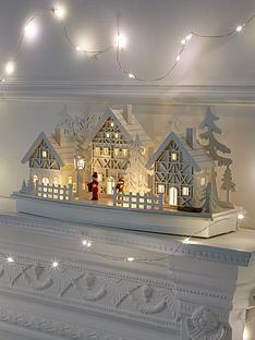 white-wood-lit-village-scene-christmas-decoration