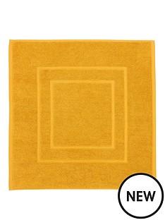 christy-brixton-850gsm-towelling-bath-mat-saffron