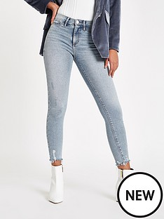 river-island-molly-skinny-jeans-with-distressed-hem-light-blue