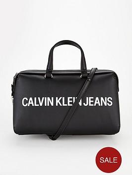calvin-klein-logo-zipper-shoulder-barrel-bag-whiteblack