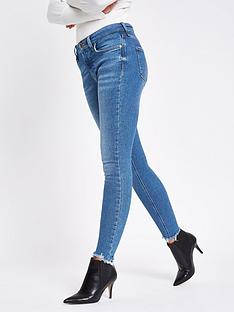 river-island-river-island-amelie-mid-rise-chewed-hem-super-skinny-jeans-mid-blue