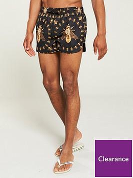 hermano-printed-bee-beach-shorts-blackgold