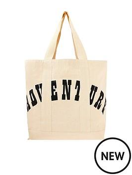 accessorize-adventure-slogan-shopper-cream
