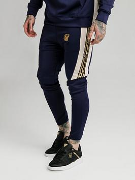 sik-silk-hybrid-panel-tape-fitted-pants-navy