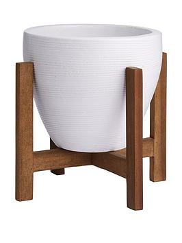 Very White Ceramic Planter On Low Wooden Stand Picture