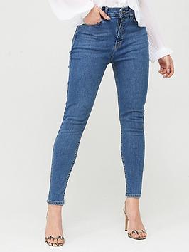 Boohoo    Butt Shaper Mid Rise Skinny Jeans - Mid Blue