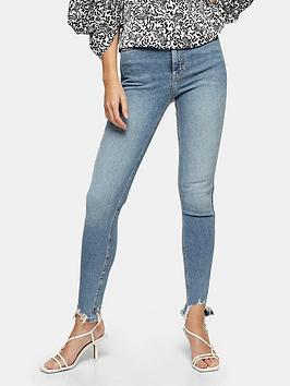 Topshop Topshop 34' Jagged Hem Jamie Jeans - Bleached Blue Picture