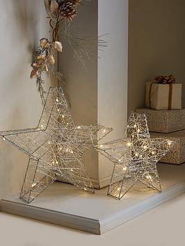 set-of-2-light-up-star-christmas-room-decorations