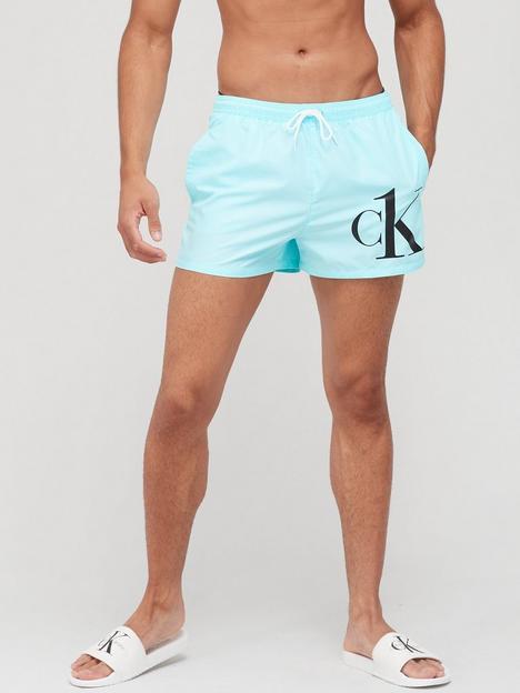 calvin-klein-ck-logo-swim-shorts-tanger-turquoise