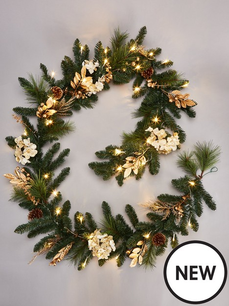 pre-lit-hydrangea-christmas-garland-in-gold-ndash-270-cm